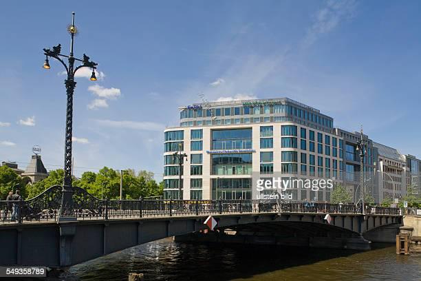 view on river 'Spree' the bridge 'Weidendammer Bruecke' and office building 'Spreekarree' at the street 'Friedrichstrasse'