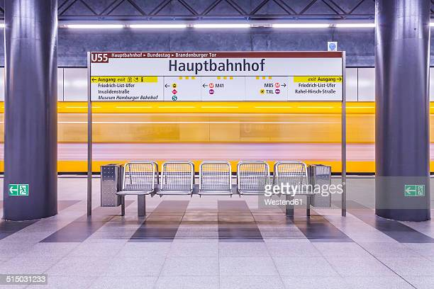 germany, berlin, modern architecture of subway station hauptbahnhof, central station, with moving underground train - bahnhof stock-fotos und bilder