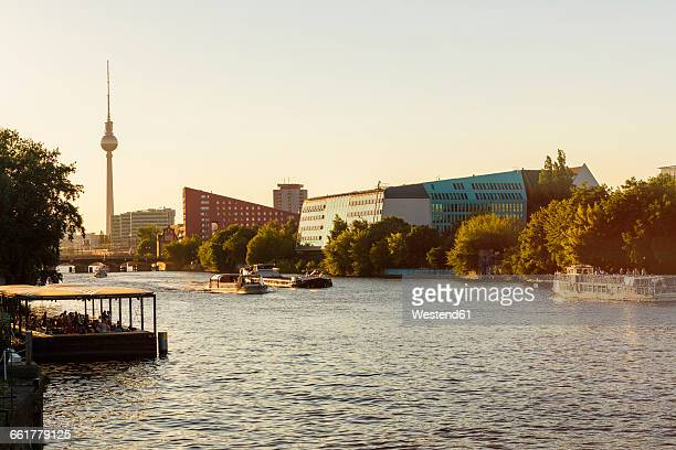 germany, berlin, modern buildings at spree riverside and television tower in the background - spree river stock pictures, royalty-free photos & images