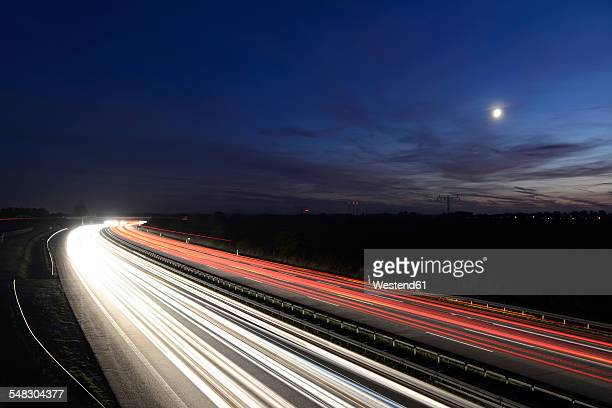 Germany, Berlin, motorway and light trails at night