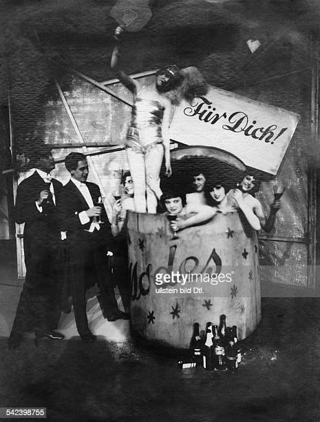 Germany Berlin new year's eve girls with champaigne glasses sitting in a wine barrel from the Erik Charel revue 'For you' 1926 Photographer Sasha...