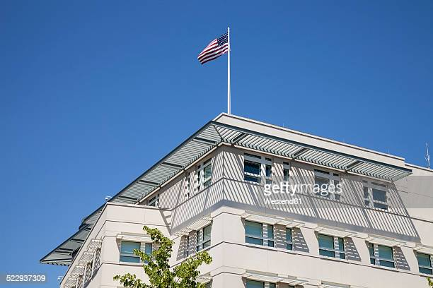 Germany, Berlin, Part of facade of US embassy with American flag
