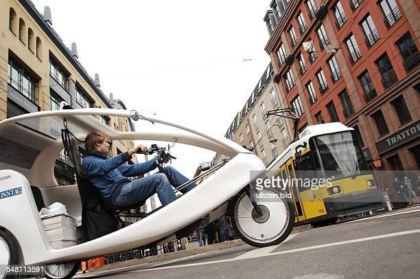 Germany Berlin - pedicab and tram at am Hackescher Markt -