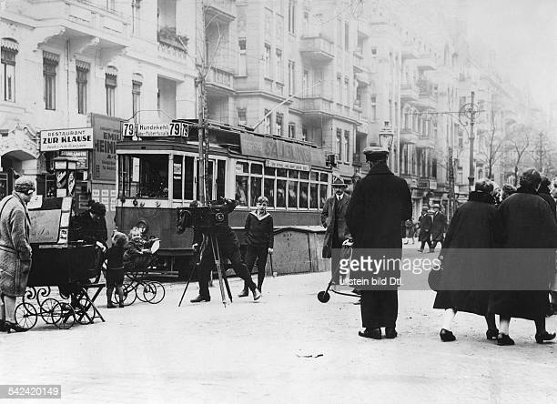 Germany Berlin photographer at work in the street Strassenbahn 1929 Photographer Herbert Hoffmann Published by 'Tempo' Vintage property of ullstein...