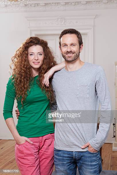 Germany, Berlin, Portrait of couple at home