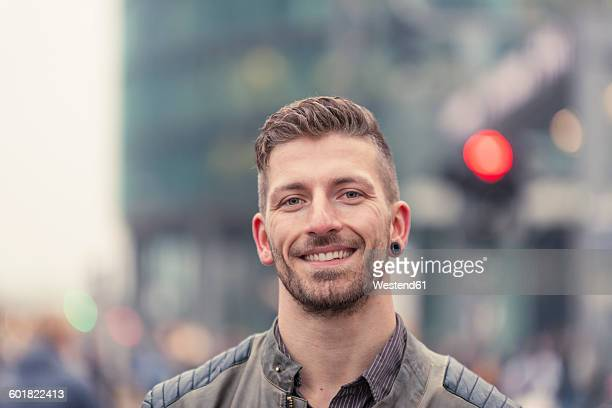 Germany, Berlin, portrait of smiling man