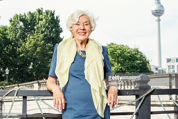 Germany, Berlin, portrait of smiling senior woman
