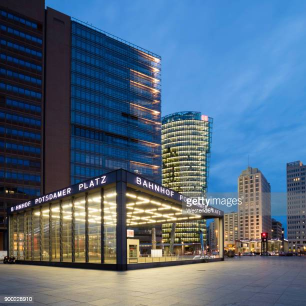 Germany, Berlin, Potsdamer Platz, lighted railway station at twilight