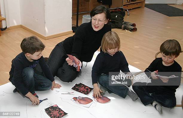 Germany Berlin pre school education in natural science at a kindergarten childrenlearning something about the human heart
