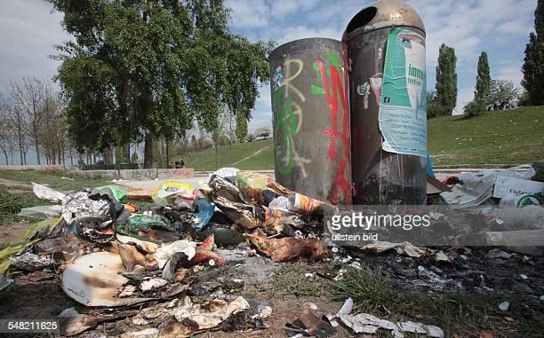 Germany Berlin Prenzlauer Berg overflowing garbage bin after the Easter weekend in the Mauerpark