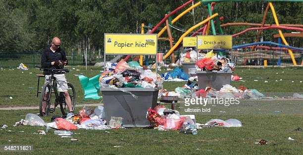 Germany Berlin Prenzlauer Berg overflowing garbage container after the Easter weekend in the Mauerpark