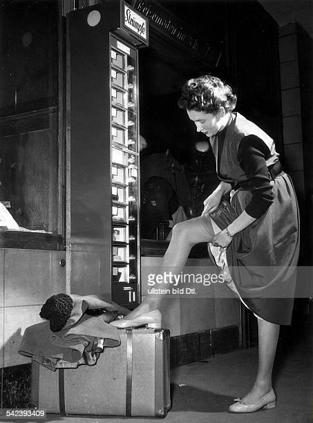 Germany Berlin railway station Bahnhof Zoologischer Garten Automat for nylon stockings 1953