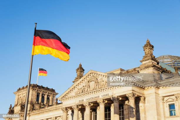 germany, berlin, regierungsviertel, reichstag building with german flags - flagpole stock pictures, royalty-free photos & images