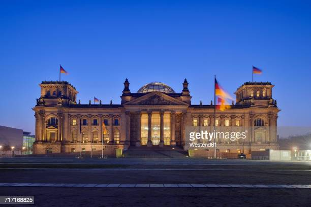 Germany, Berlin, Reichstag building illuminated at dus