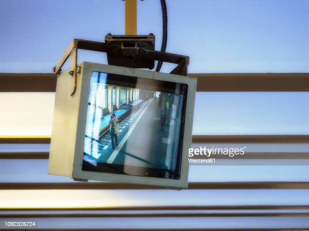 germany, berlin, screen from video surveillance, photograper at s-bahn station - big brother orwellian concept stock pictures, royalty-free photos & images