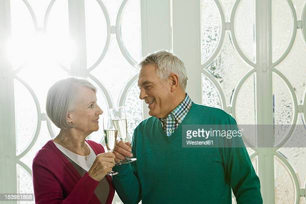 Germany, Berlin, Senior couple drinking champagne