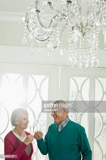 Germany, Berlin, Senior couple drinking champagne