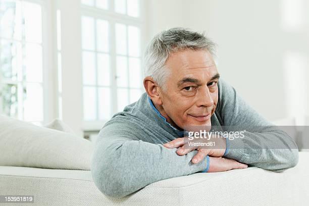 Germany, Berlin, Senior man on couch, portrait
