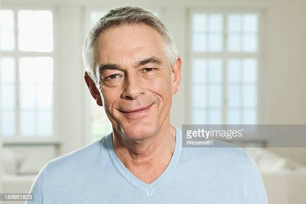 Germany, Berlin, Senior man smiling, portrait