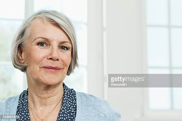 Germany, Berlin, Senior woman smiling, portrait