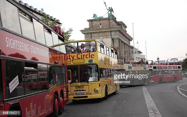 Germany Berlin - sightseeing buses behind the Brandenburg Gate