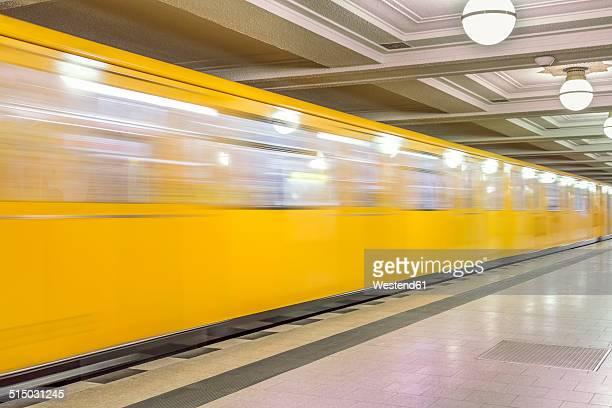 Germany, Berlin, subway station Hohenzollernplatz with moving underground train