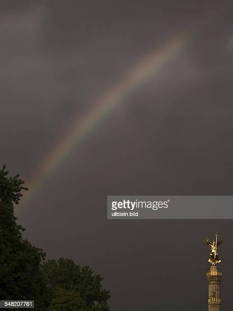 Germany Berlin Tiergarten - The reconstructed victory column 'Siegesaeule' in the evening with rainbow.