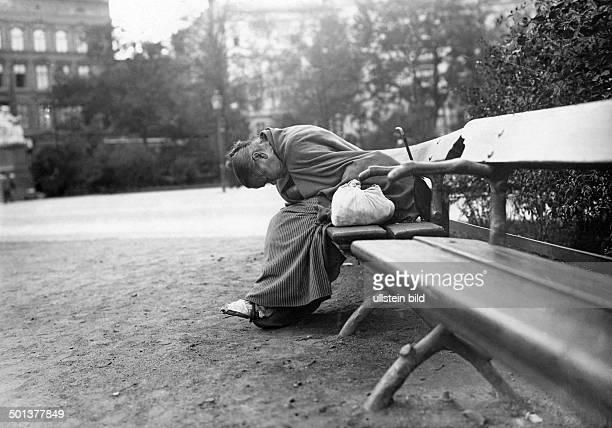 Germany Berlin Tiergarten woman sleeping on a park bench date unknown