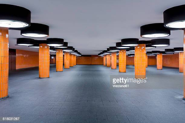 germany, berlin, unfinished subway station at the international congress centrum - orange farbe stock-fotos und bilder