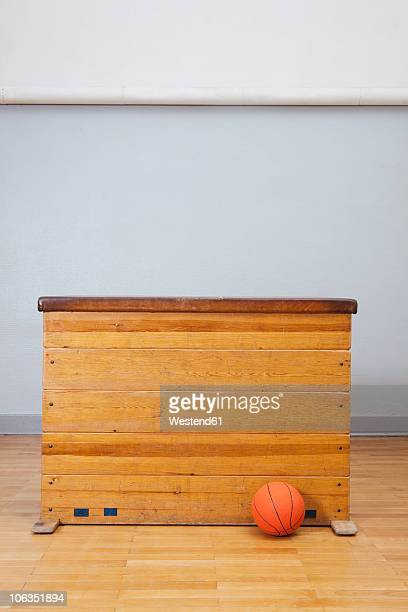 Germany, Berlin, Vaulting horse with basketball in school gym