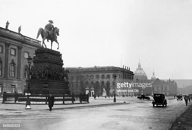 Germany Berlin view from the Straße 'Unter den Linden' to the equestrian sculpture of Frederick II in the background the university the Armory and...
