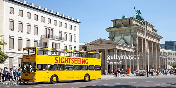 germany, berlin, view to brandenburg gate and place of march 18 with tour bus in the foreground - double decker bus stock pictures, royalty-free photos & images