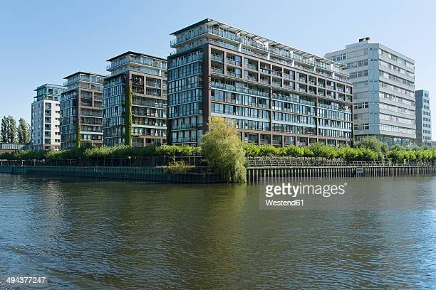 Germany, Berlin, view to modern multi-family houses and office buildings at Spree River