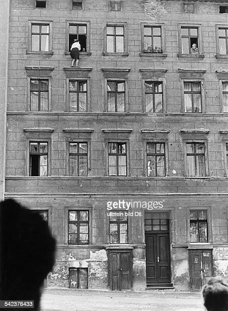 Germany Berlin wallEscapes and escape attempts from East Germany Escape of a family of 3 persons from a building at 'Bernauer Street' that is...