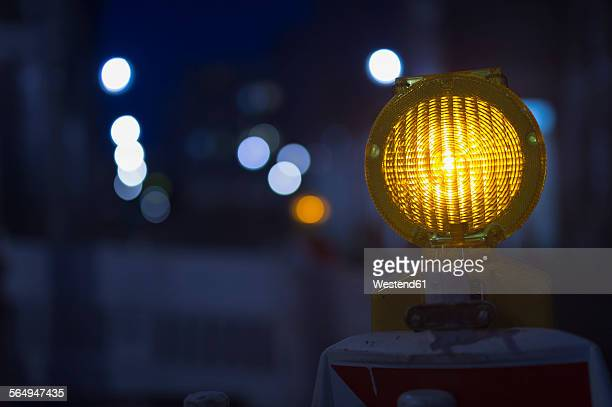 Germany, Berlin, warning light at construction site