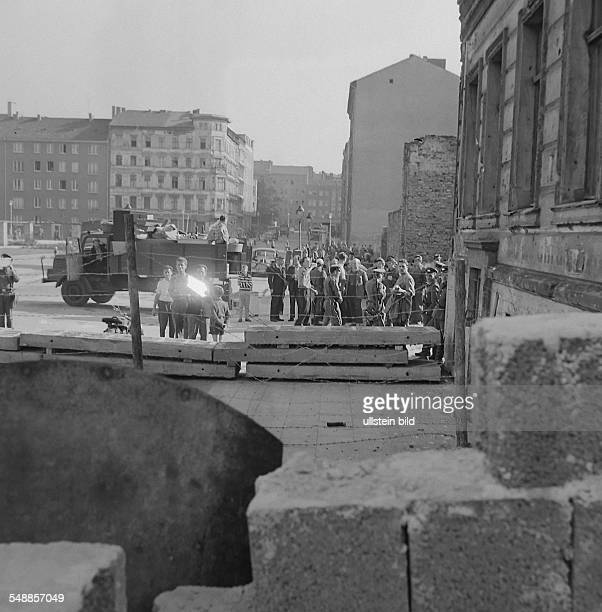 Germany Berlin Wedding GDR police glaring photographers in West Berlin taking pictures of the eviction of the houses at Bernauer Strasse at border...