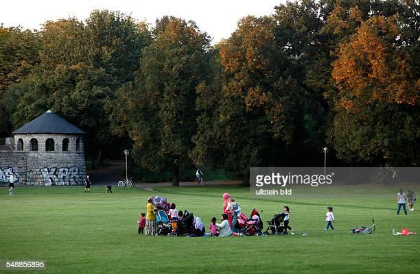 Germany Berlin Wedding women and children in the Schillerpark