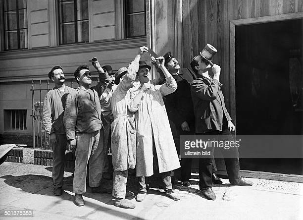 Worker watching the solar eclipse undated probably 1908 Photographer Haeckel