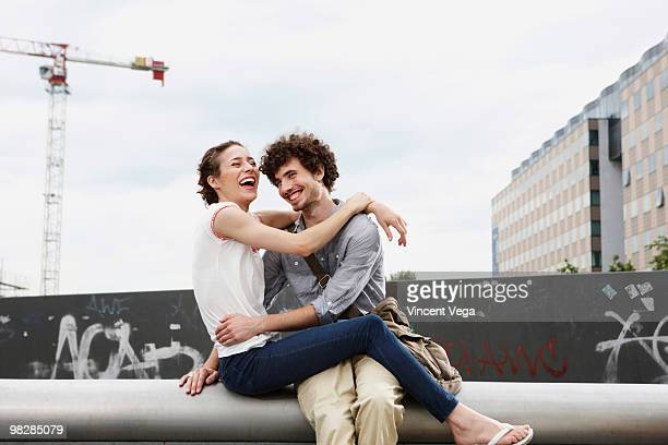 Germany, Berlin, Young couple embracing, smiling