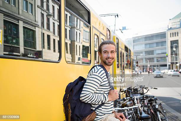 Germany, Berlin, Young man waiting for his girl friend