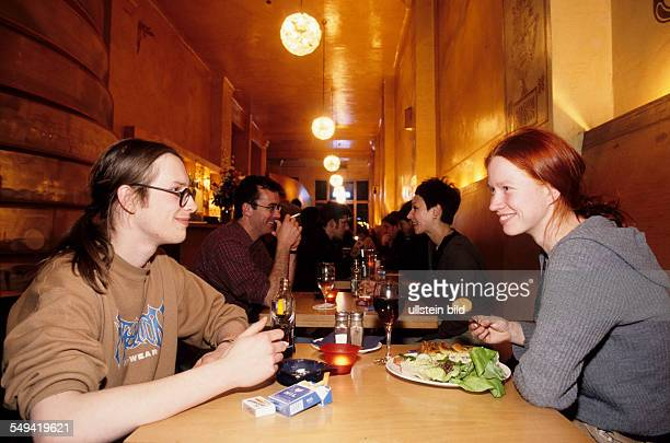 Young persons in a cafe