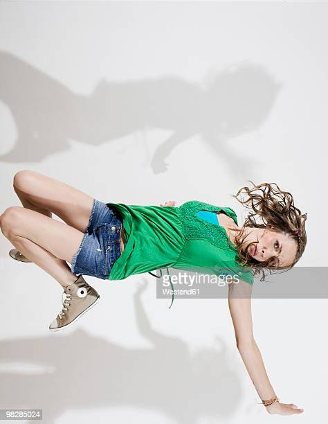 Germany, Berlin, Young woman breakdancing, portrait