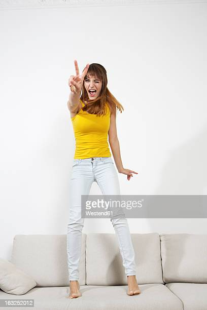 Germany, Berlin, Young woman having fun, smiling