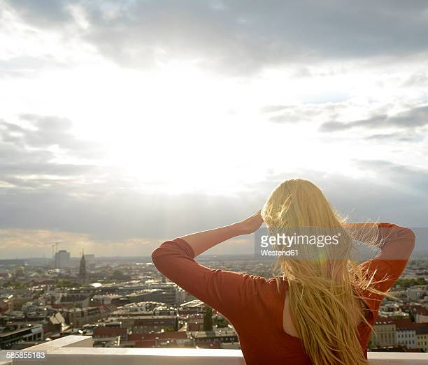 Germany, Berlin, young woman looking at view