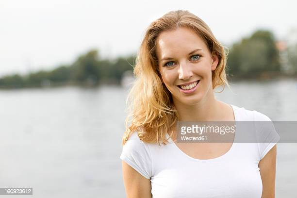 Germany, Berlin, Young woman smiling, portrait