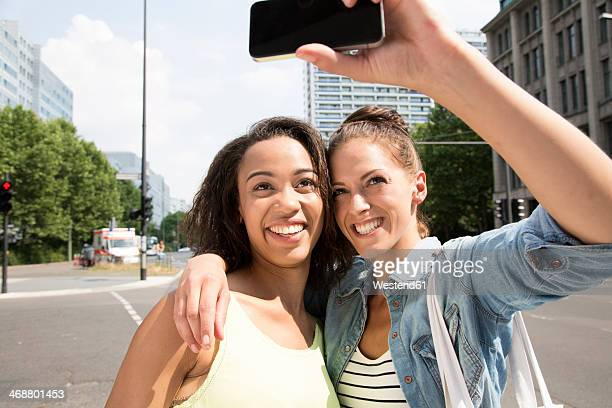 Germany, Berlin, Young women fotographing selves