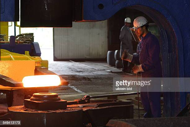 Forging of the 5 tons hammer of the wheel tyre and wheelset manufacturer Bochumer Verein Verkehrstechnik A worker in Schutzkleidung at directing