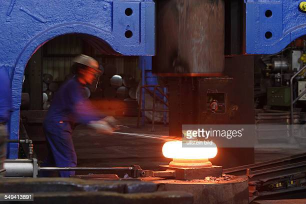 Forging of the 5 tons hammer of the wheel tyre and wheel set manufacturer Bochumer Verein Verkehrstechnik A worker at forging