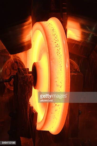 Forming at the wheel rolling mill of the wheel tyre and wheelset manufacturer Bochumer Verein Verkehrstechnik A glowing wheel