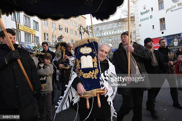 The symbolic transportation of three Thora rolls from the former place of the synagogue in the town centre to the new synagogue at the...